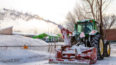 A hunt club east snowblower clears snow in Ottawa