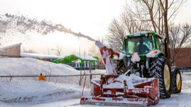 A hunt club east snowblower clears snow in Ottawa