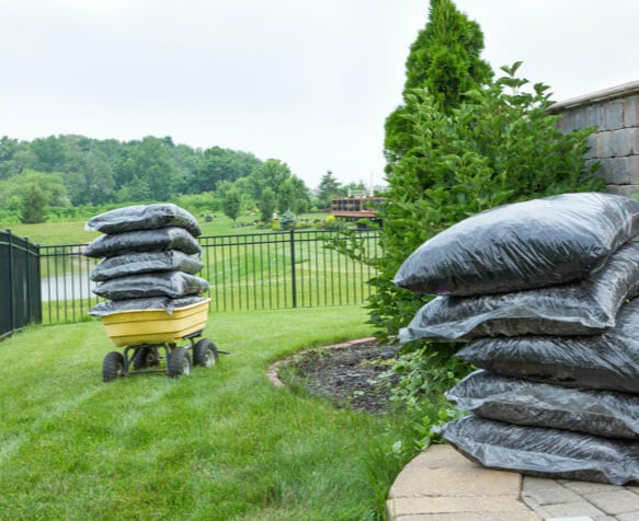 An Ottawa backyard in the process of getting its gardens mulched by Hunt Club East Snow & Lawn