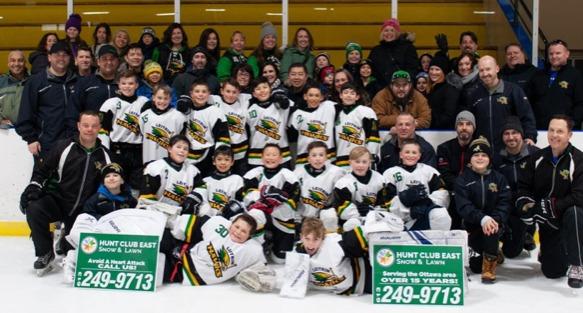 A local hockey team sponsored by Hunt Club East Snow & Lawn