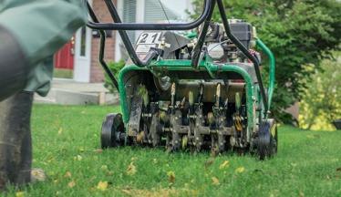 An Ottawa lawn gets aerated by a Hunt Club East aerator