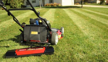 Close up of a lawnmower cutting an Ottawa lawn