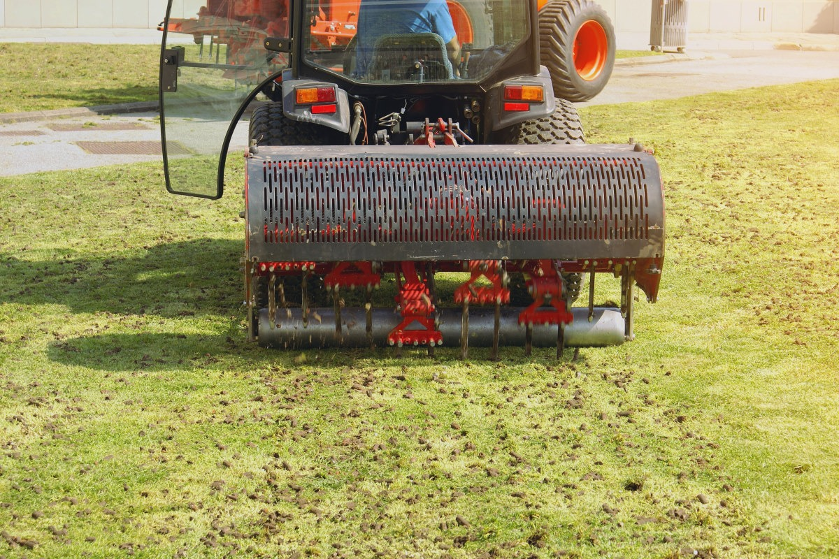 an aeration tractor being used to aerate a lawn